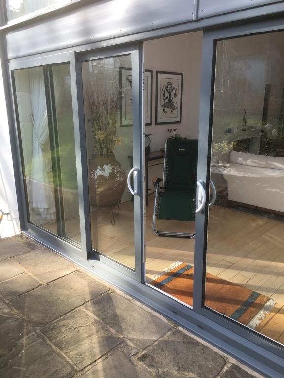 Aluminium window installation aire valley glass for Aluminium window installation